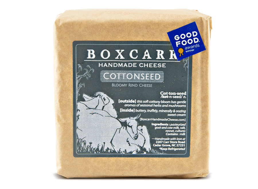 Boxcarr cottonseed handmade cheese wrapped in paper with a gray label